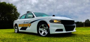KCSO cruiser parked on grass