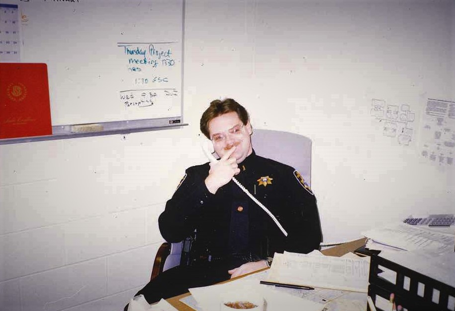 Chief Keith Lyon smiling on phone