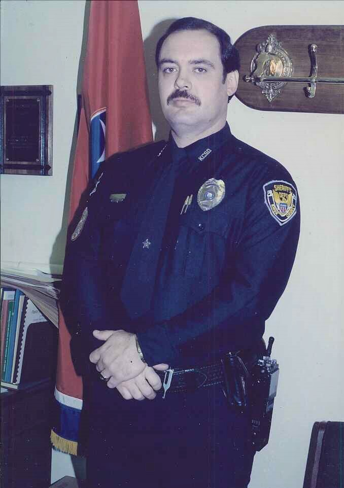LT McCulley standing and looking at camera
