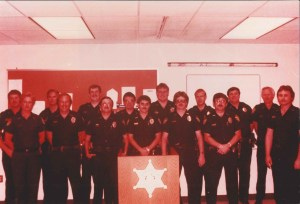 1970's ish photo of several officers