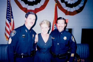 Sheriff, another officer, and woman smiling at camera