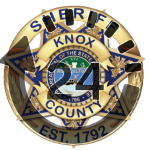 "KCSO badge with ""24"" overlay"
