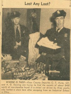 Old newpaper cutout of two KCSO deputies and recovered stolen merchandise