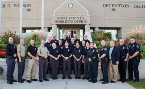 COTA recruits with Sheriff, Chief Deputy, and other instructors on steps of detention facility