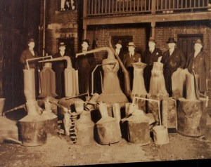 Black and white image of officers standing behind several stills