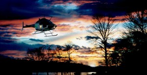 KCSO helicopter in air at sunset