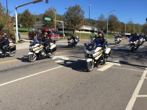 Several KCSO motorbike officers driving down road