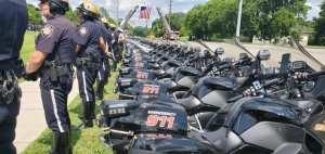 Several KCSO motorbike officers standing in line behind their motorbikes