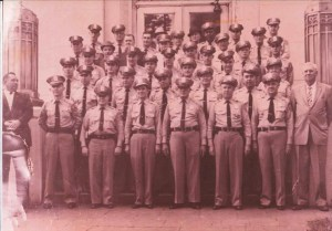 Very old photo of officers posing on steps