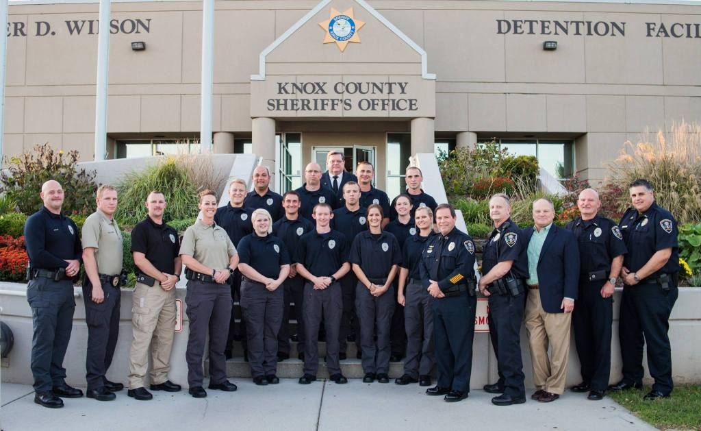 KCSO Corrections officers, supervisors, Sheriff posing on Detention facility steps