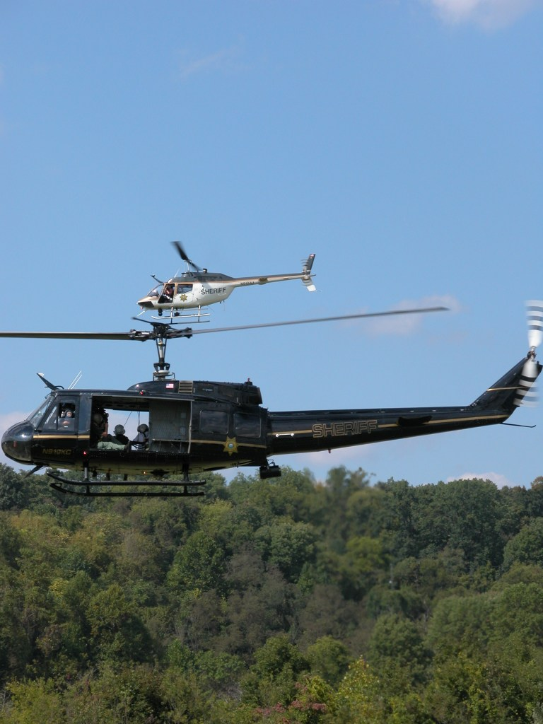 Two KCSO helicopter flying