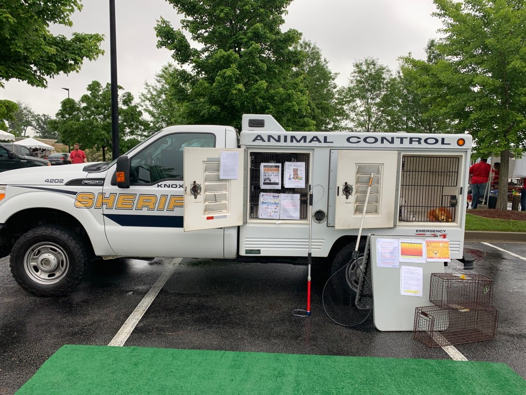 Animal Control truck with compartments open