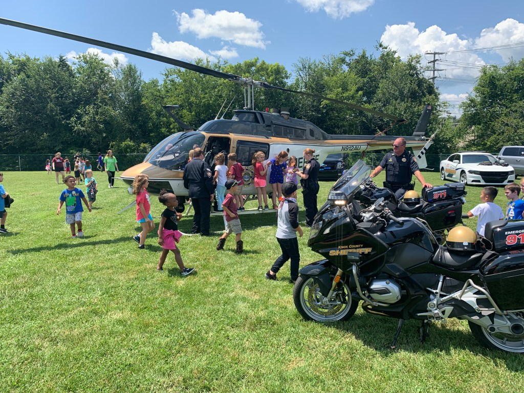 Children looking at KCSO helicopter and motorbikes
