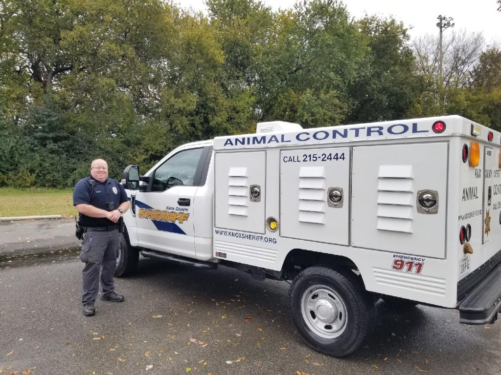 Animal Control officer next to truck