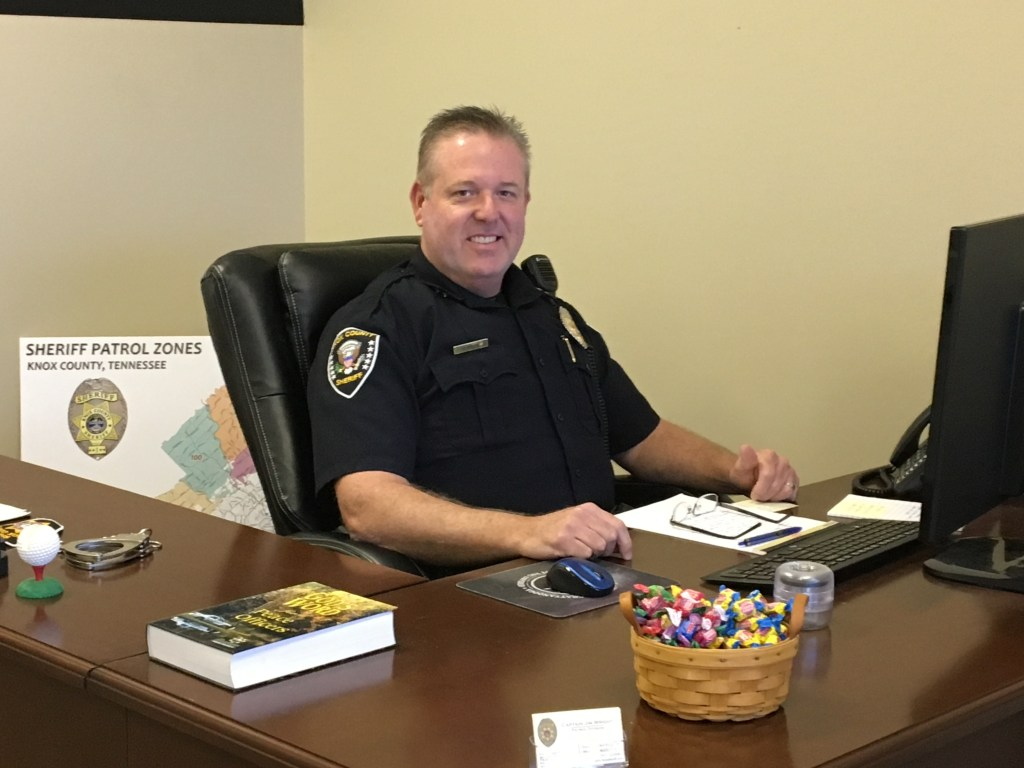 North Precinct Captain Smiling at desk