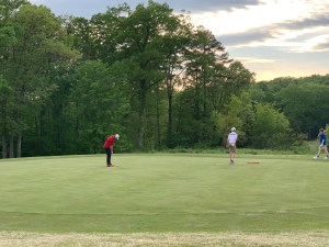 Golf course with three players