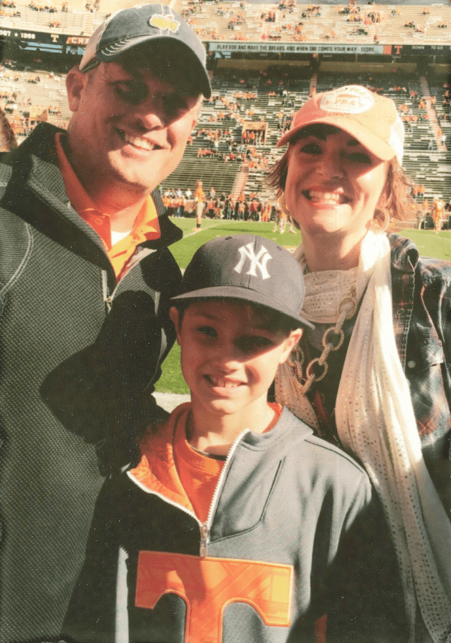 Chief Workman with wife and son at ballgame