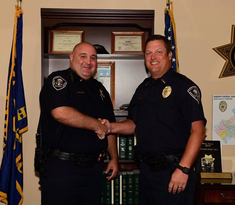 Chief workman shaking hands with a lieutenant