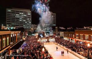 Crowded Market Square with ice rink and fireworks