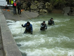 SURT officers treading a body of water as other officers maintain safety lines with them