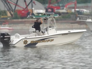 Sheriff boat with two officers driving in water