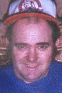 Headshot image of Mr. McGhee with hat