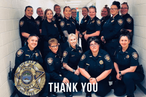 "Group of female corrections officers with badge and ""Thank You"" at bottom"