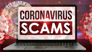 "Computer with ""coronavirus scam"" and KCSO badge overlay"