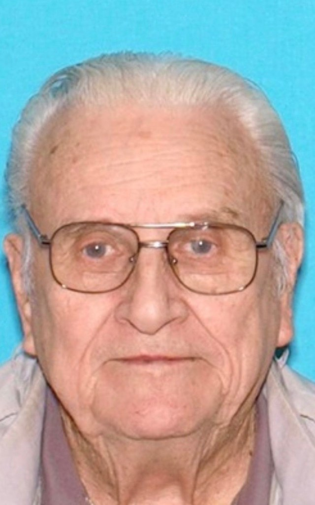 Headshot of White elderly man with glasses