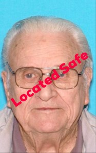 """Located Safe"" Headshot of White elderly man with glasses"