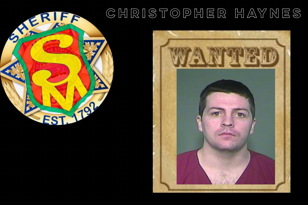Mugshot of white male, short dark hair on wanted poster with SafetyMan badge