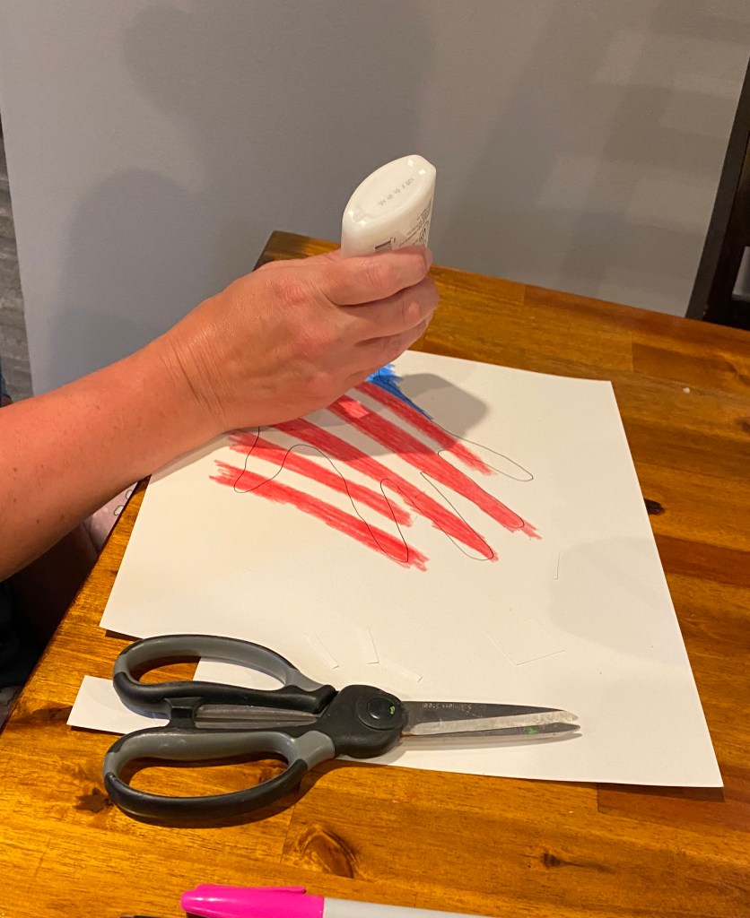 colored hand tracing with scissors, and someone applying glue