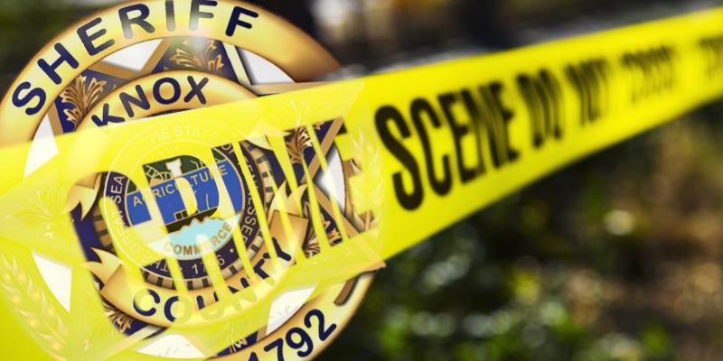 Crime Scene Tape diagonal over KCSO Badge
