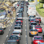 """""""2020 Weekend Memorial Day Stats with opaque KCSO badge and traffic in background"""