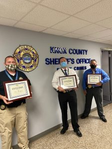 3 KCSO detectives holding awards