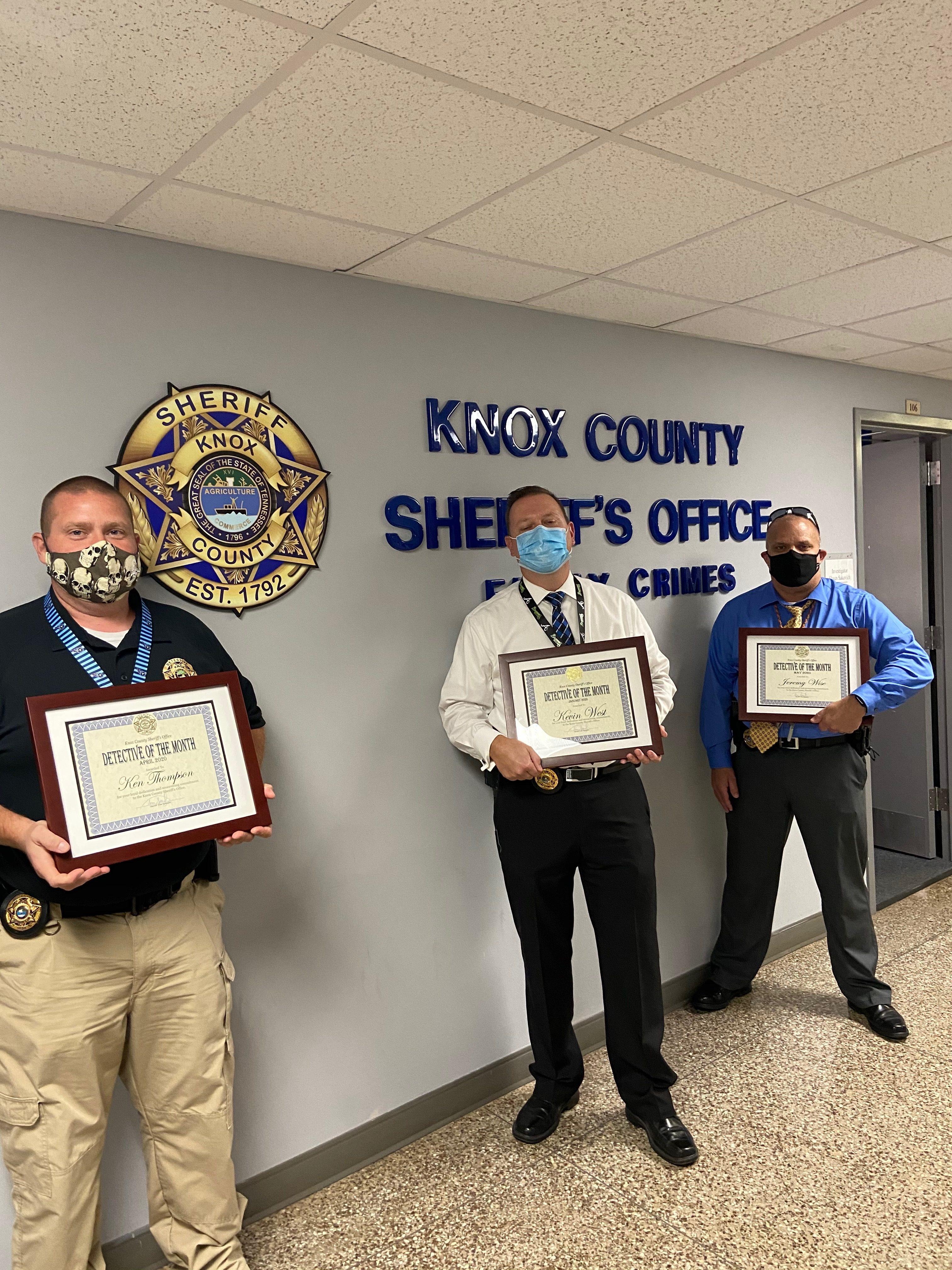 3 KCSO detectives holding awards