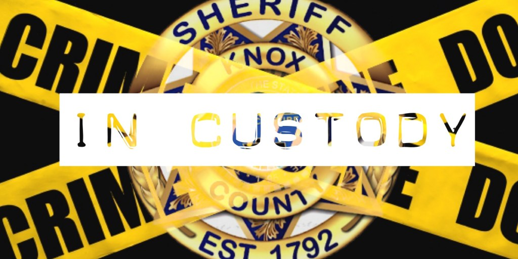 "KCSO Badge with crossed caution tape and ""In Custody"""