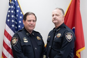 Sheriff Spangler standing with Chief Lyon