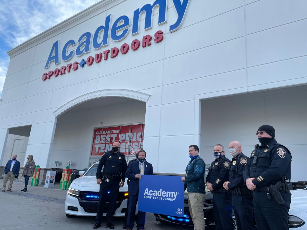 Officers standing outside Academy Sports entrance