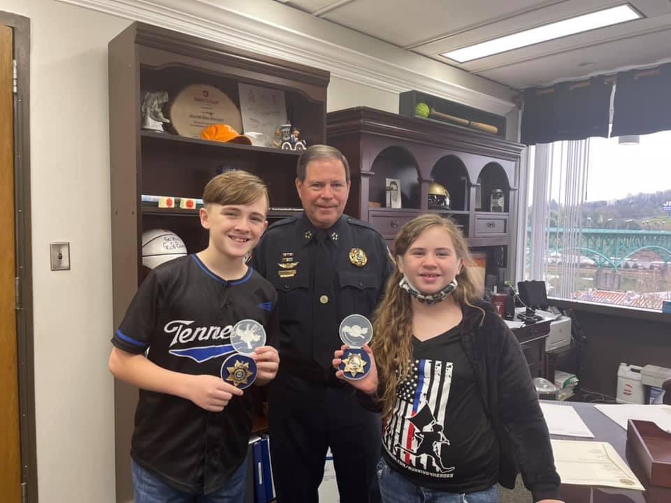 Sheriff, Zachariah, and girl standing in Sheriff's Office