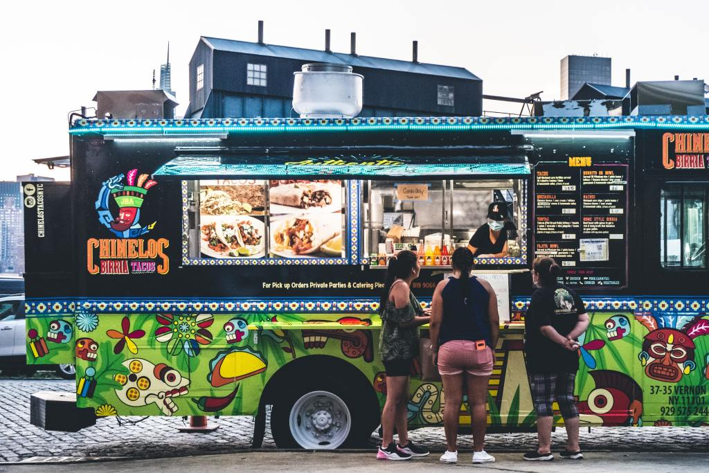 people standing at food truck