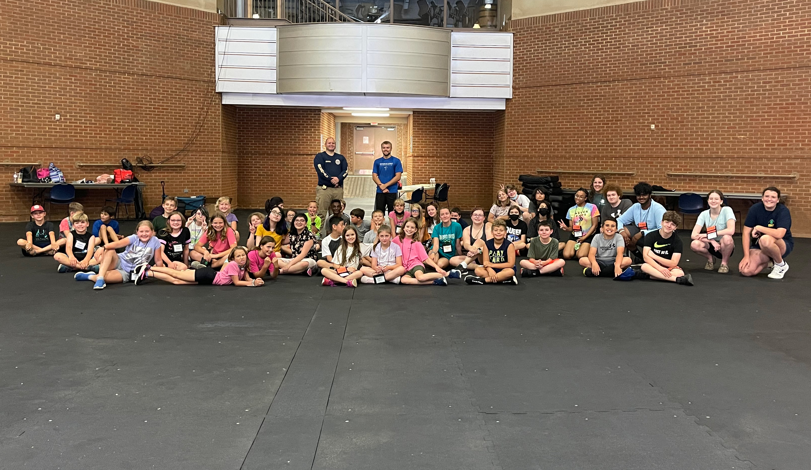 4-H youth with Officer McMahan and Mr. Nokes