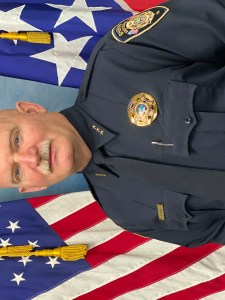 Chief Purvis between TN and USA flags