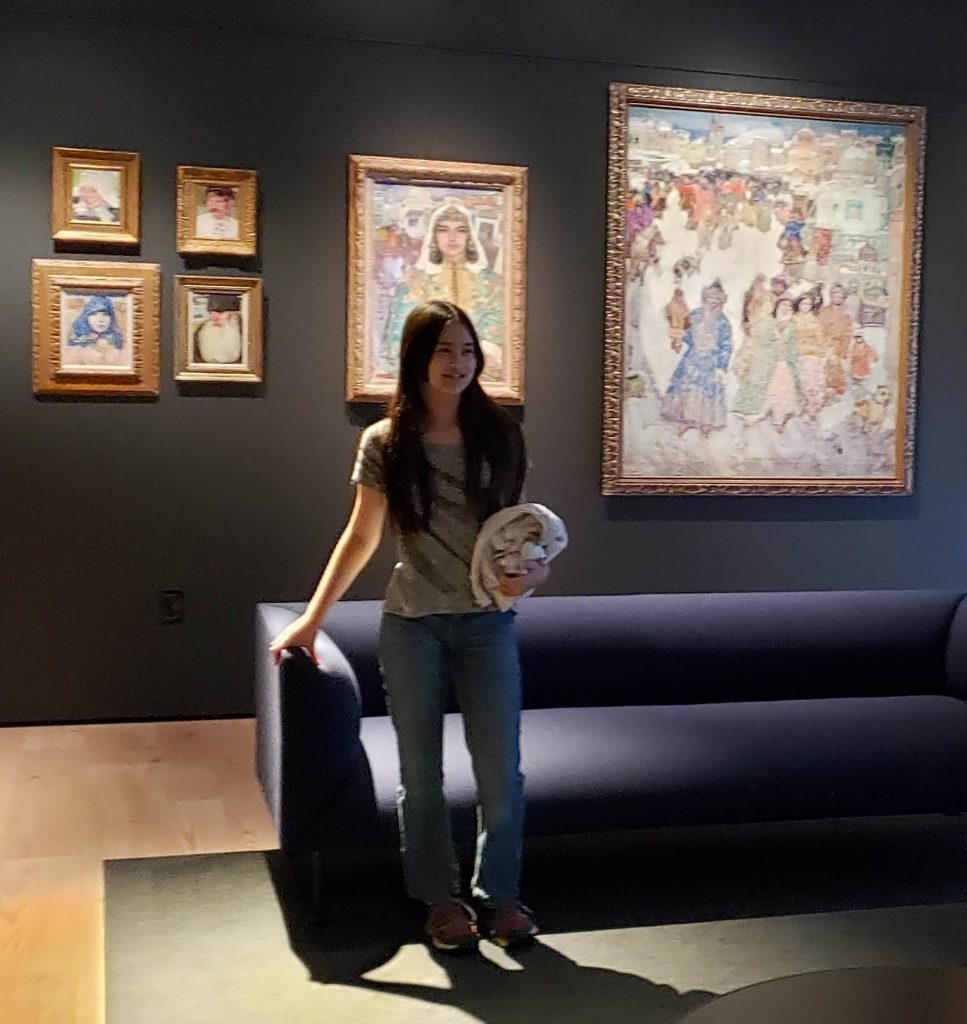 Kayla Wong standing by couch in museum in AK