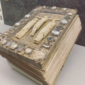 Denmark's Second Oldest Book. The book from Home is a book of Gospels from around 1225. From 1656 to 1810 it was kept on the altar of Home Church in Funen. Before then the book belonged to Danish noble families who decorated its pages with their coats of arms. In 1810 Count Preben Bille-Brahe donated the book to the National Museum. The cover of the book is decorated with Christ on the cross, flanked by Mary and John the Baptist.