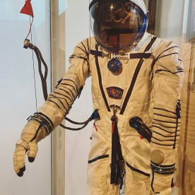 """Space Suit - The First Dane in Space. In 2015 Andreas Mogensen spent eight days on the International Space Station ISS. His trip into space and back was on the Russian Soyuz spacecraft. During the trip, Andreas wore a white suit to protect him from falling atmospheric pressure and other challenges in space. During his time at the space station, he wore a black suit to protect him from the negative effects of zero gravity. Andreas was the first Dane in space. Describing the experience he said: """"It's like being a child on a swing flying towards the clouds. The instant you leave the ground and your feet point to the sky, time just standstill."""""""