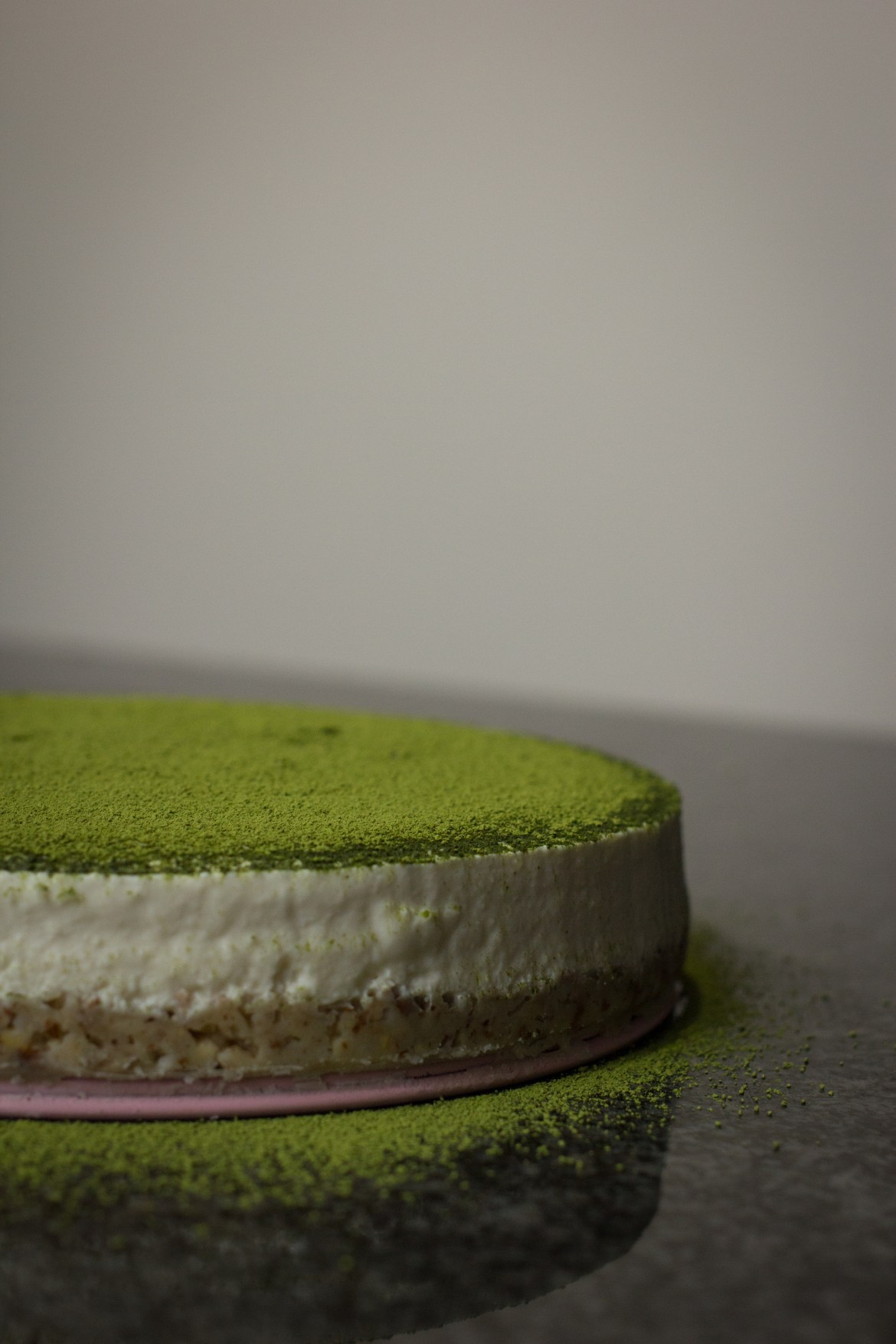 Side view of Tofu Matcha Cheesecake with Coconut Nutty Base