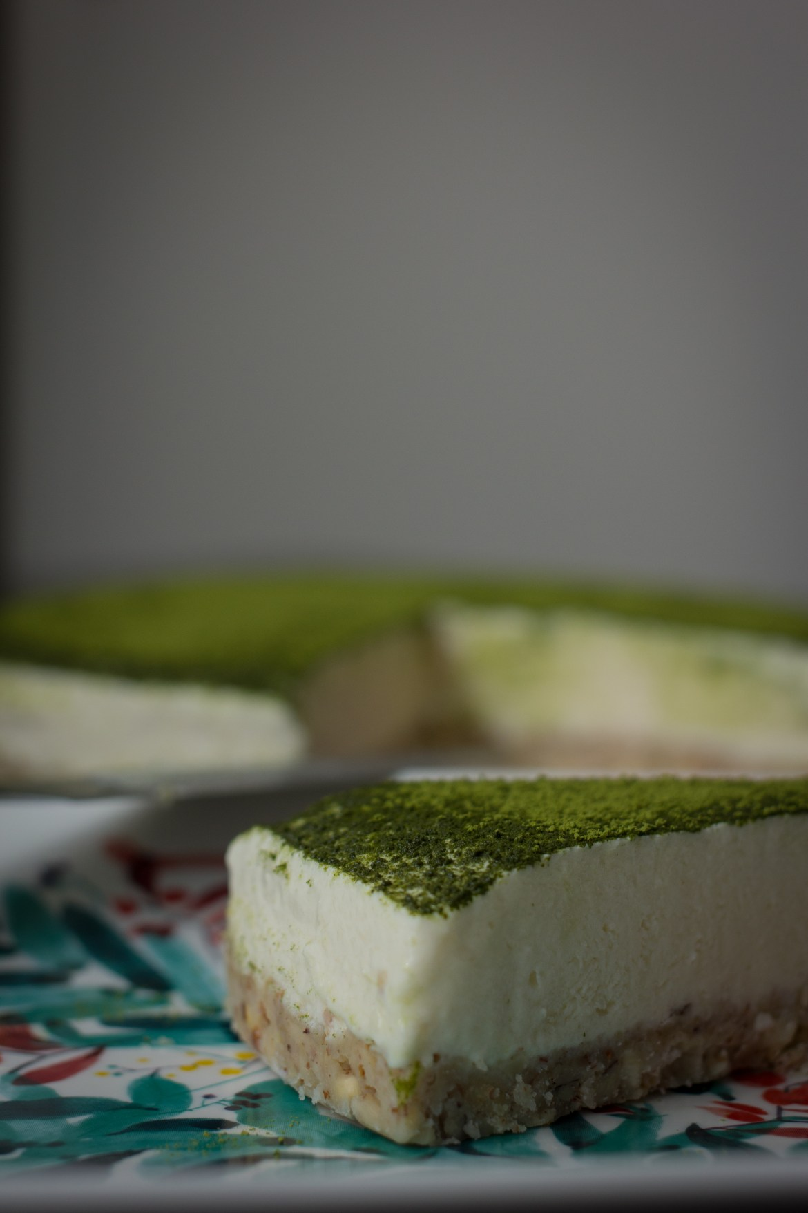 Slice of Tofu Matcha Cheesecake with Coconut Nutty Base