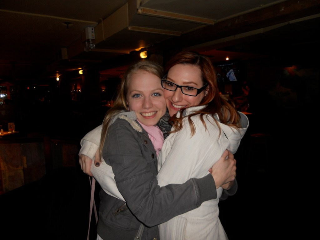 KWL intern Rachel with Sam Maggs hugging in a college bar in 2009.