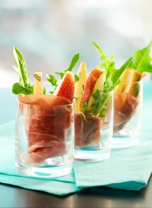 appetizer with pear,prosciutto,arugula,gorgonzola in glasses